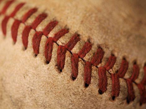 A closeup view of an old baseball