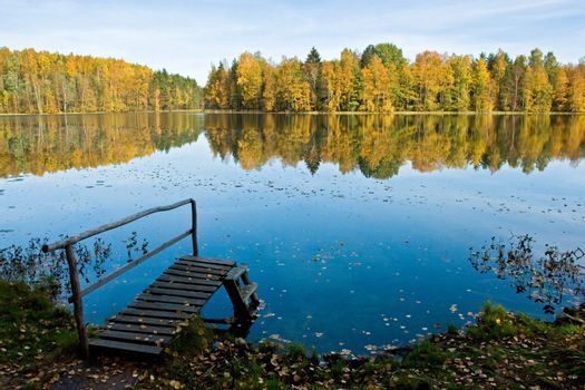 Autumn on a quiet forest lake