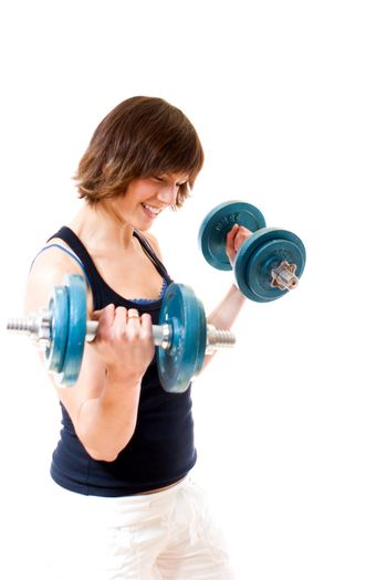 Young woman lifiting weights