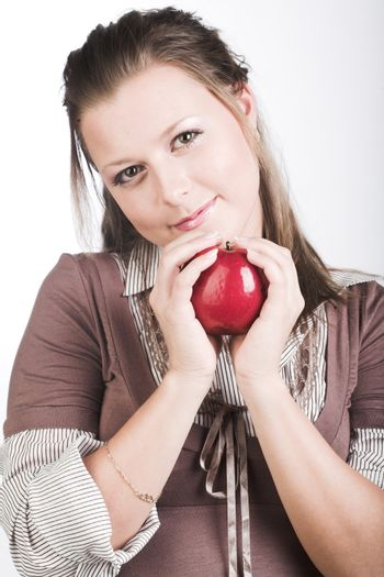 beautiful young smiling woman with red apple.