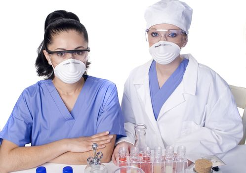 Young scientist in laboratory with test tubes and chemicals
