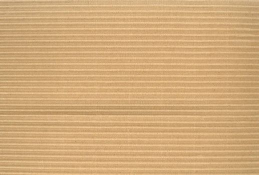 Recycled corrugated cardboard detail, intentionally imperfect and ready to use as a texture, pattern, or background.