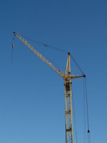 The elevating crane and blue sky