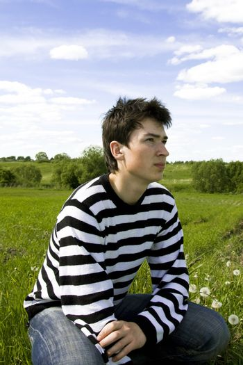 Portrait of the young guy on nature background