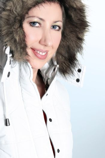 Winter woman in a hooded parka