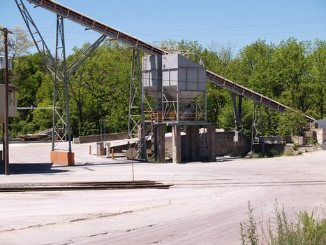 conveyor apparatus at an industrial site
