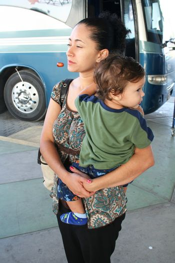 mother and child waiting at bus terminal