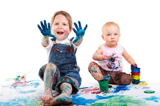Cute 5 years old boy and toddler girl painting on white background