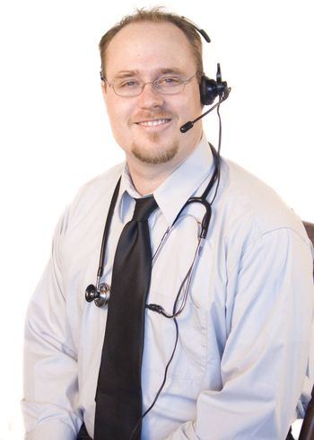 Doctor with headset chatting on phone