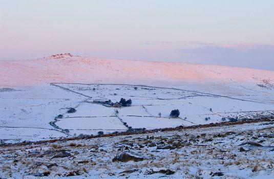 A desolate Dartmoor farm in the snow