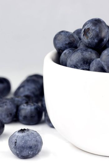 fresh washed blueberries in a white bowl