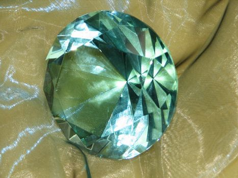 Glass cut in form of a gemstone