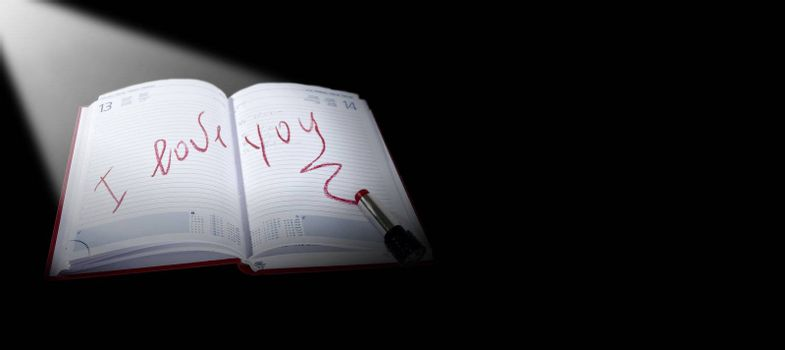 I love you written in lipstick on a calendar