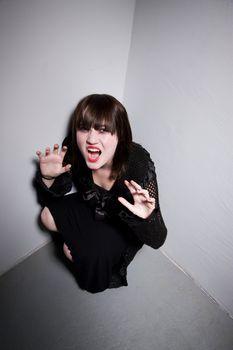 Frightened Girl in a Corner
