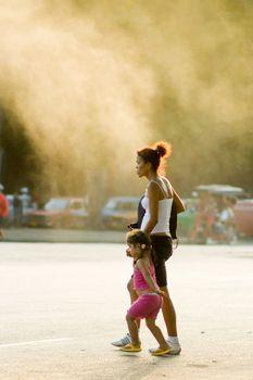Child in city smog