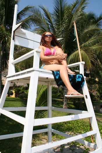 Sexy model on lifeguard tower