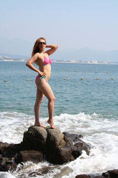 Portrait of beautiful woman on beach and rocks
