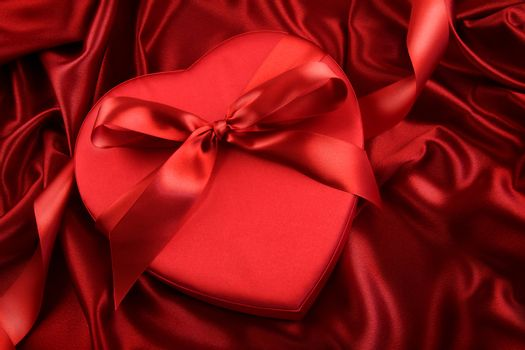 Box of chocolate on red satin