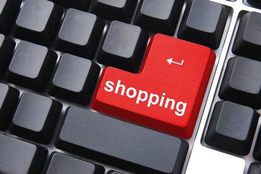 shopping concept with computer enter key on keyboard