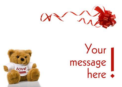 A Valentines teddybear holding frame