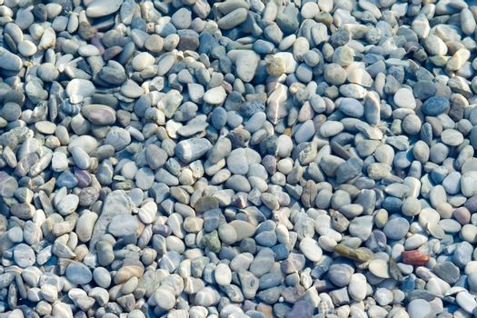 Pebbles background under water surface