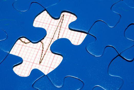 An EKG underneath a bright blue puzzle.