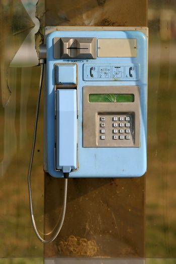 Public phone on a sunny day