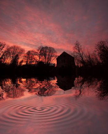 house at sunset with reflection