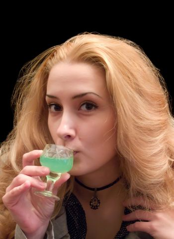 The long-haired girl with a wine-glass of absinthe liqueur