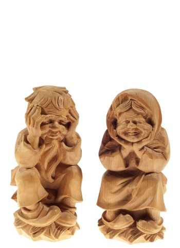 Two wooden statues divecchietti on white background