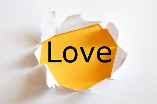 love on yellow background in a hole