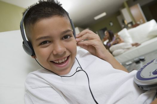 Boy Listening to Music on Portable CD Player