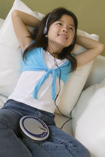 Girl Listening to Music on Portable CD Player