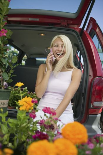 Woman Using Cell Phone at Plant Nursery
