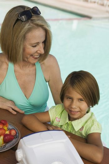 Girl and Grandmother at the Pool
