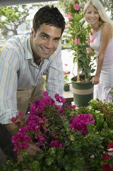 Couple Selecting Plants