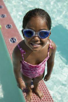 Girl Wearing Goggles on Edge of Swimming Pool