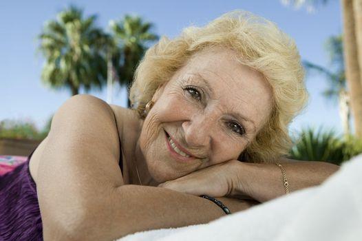Senior Woman Lying Down Outside