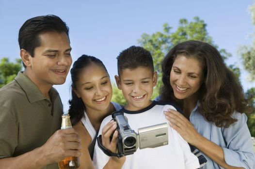 Family Watching Video Camera