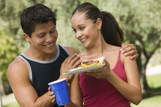 Couple Sharing Food at Picnic