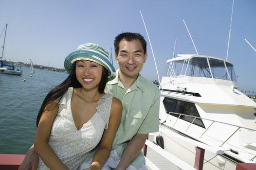 Couple Near Yacht in Marina