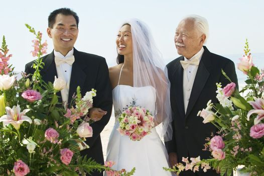 Bride and Groom With Father