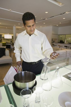 Man Examining Kitchenware