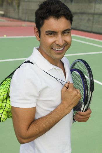 Tennis Player Carrying Equipment