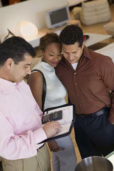Salesman Calculating Couple's Purchase Amount