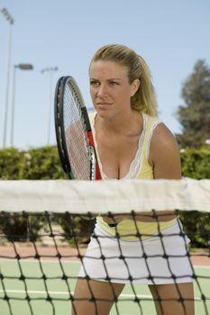Woman Playing Tennis at Net