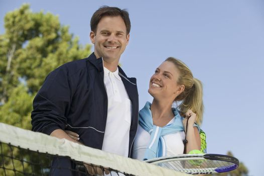 Couple at Tennis Net