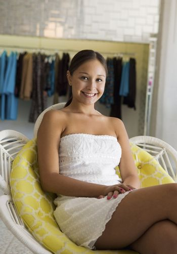 Girl Relaxing in Clothing Boutique