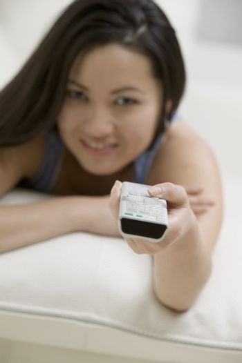 Young Woman on Couch with Remote Control