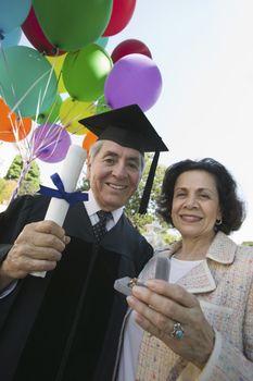 Wife Giving Husband Graduation Gift